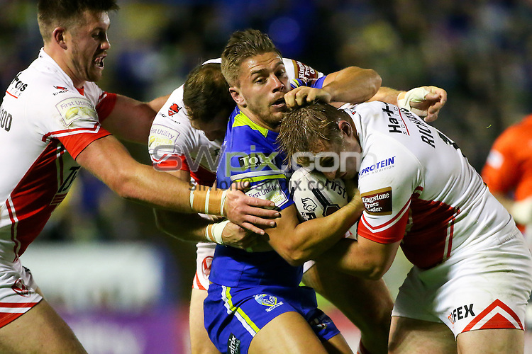 Picture by Alex Whitehead/SWpix.com - 29/09/2016 - Rugby League - First Utility Super League Play-off Semi-Final - Warrington Wolves v St Helens - Halliwell Jones Stadium, Warrington, England - Warrington's Matty Russell is tackled by St Helens' Joe Greenwood, James Roby and Greg Richards.
