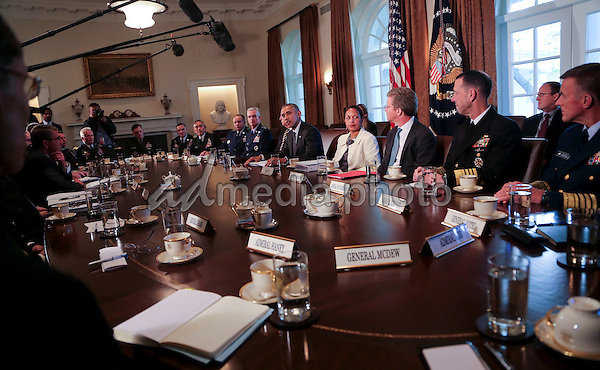 United States President Barack Obama meets with Combatant Commanders and Joint Chiefs of Staff in the Cabinet Room of the White House, in Washington, DC, April 5, 2016. Photo Credit: Aude Guerrucci/CNP/AdMedia