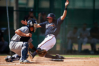 Atlanta Braves Jose Bermudez (15) slides into home as catcher Brady Policelli (71) swipes the tag during an Instructional League game against the Detroit Tigers on October 10, 2017 at the ESPN Wide World of Sports Complex in Orlando, Florida.  (Mike Janes/Four Seam Images)