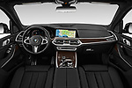 Stock photo of straight dashboard view of a 2019 BMW X7 40i 5 Door SUV