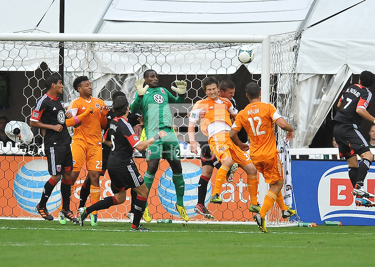 Bobby Boswell (32) of the Houston Dynamo heads the ball against Perry Kitchen (23) of D.C. United. The Houston Dynamo defeated D.C. United 4-0, at RFK Stadium, Wednesday May 8 , 2013.