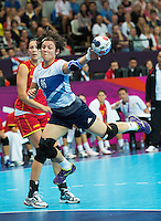 28 JUL 2012 - LONDON, GBR - Marie Gerbron (GBR) of Great Britain shoots during the women's London 2012 Olympic Games Preliminary round handball match against Montenegro at The Copper Box in the Olympic Park, in Stratford, London, Great Britain .(PHOTO (C) 2012 NIGEL FARROW)