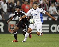 Clyde Simms #19 of D.C. United clashes with Eduardo #23 of the San Jose Earthquakes during an MLS match at RFK Stadium in Washington D.C. on October 9 2010. San Jose won 2-0.
