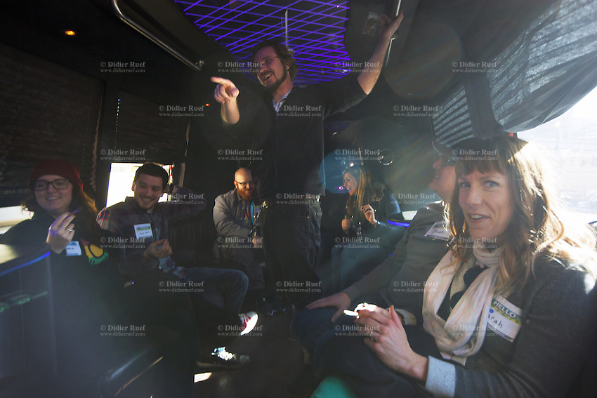 USA. Colorado state. Denver. Sarah (R) and her husband Shawn smoke a joint during their tourist Cannabis Bus tour. The couple came from Nebraska for a weekend to discover the newly legalized recreational marijuana market. Cannabis, commonly known as marijuana, is a preparation of the Cannabis plant intended for use as a psychoactive drug and as medicine. Pharmacologically, the principal psychoactive constituent of cannabis is tetrahydrocannabinol (THC); it is one of 483 known compounds in the plant, including at least 84 other cannabinoids, such as cannabidiol (CBD), cannabinol (CBN), tetrahydrocannabivarin (THCV), and cannabigerol (CBG). 20.12.2014 © 2014 Didier Ruef