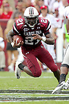 South Carolina Gamecocks tailback Marcus Lattimore (21) on the move up the middle against the Bulldogs.
