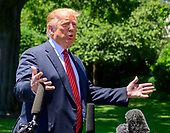 United States President Donald J. Trump takes questions from reporters as he prepares to depart the South Lawn of the White House in Washington, DC for a trip to Iowa.  He will return this evening.<br /> Credit: Ron Sachs / CNP