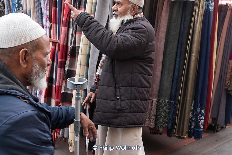 Bangladeshi stallholder, Whitechpel Market, London.