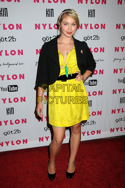 AYLA KELL.Nylon Magazine's Young Hollywood Party held at the Roosevelt Hotel's Tropicana Bar, Hollywood, California, USA..May 12th, 2010.full length hand on hip yellow dress black jacket.CAP/ADM/BP.©Byron Purvis/AdMedia/Capital Pictures.