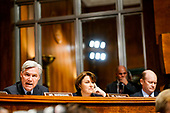 WASHINGTON, DC - SEPTEMBER 27: Left to right, Sen. Sheldon Whitehouse (D-R.I.), Sen. Amy Klobuchar (D-Minn.) and Sen. Christopher A. Coons (D-Del.) at a Senate Judiciary Committee hearing on Thursday, September 27, 2018 on Capitol Hill. (Melina Mara/Pool/The Washington Post)