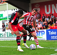 Lincoln City's Harry Toffolo vies for possession with Swindon Town's Kyle Knoyle<br /> <br /> Photographer Andrew Vaughan/CameraSport<br /> <br /> The EFL Sky Bet League Two - Lincoln City v Swindon Town - Saturday August 11th 2018 - Sincil Bank - Lincoln<br /> <br /> World Copyright &copy; 2018 CameraSport. All rights reserved. 43 Linden Ave. Countesthorpe. Leicester. England. LE8 5PG - Tel: +44 (0) 116 277 4147 - admin@camerasport.com - www.camerasport.com