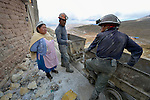 Norma Albino is a guard at a mine in Potosi, Bolivia. The mine produces silver and other metals, and Albino lives near its entrance, high on the infamous Cerro Rico. Albino, here talking with miners, is a member of the local Methodist Church.