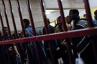 Rifugiati sudanesi nella sede della protezione civile svizzera, dopo essere stati fermati durante il tentativo di raggiungere Ginevra. Castel San Pietro,  13 gennaio, 2006<br /> <br /> Sudanese refugees in the Swiss civil defense headquarters, after being stopped while trying to reach Geneva. Castel San Pietro, January 13, 2006