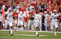Ohio State Buckeyes running back Ezekiel Elliott (15) breaks away for a long touchdown run against Wisconsin Badgers during the 1st quarter in the 2014 Big Ten Football Championship Game at Lucas Oil Stadium in Indianapolis, Ind. on December 6, 2014.  (Dispatch photo by Kyle Robertson)