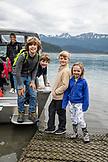 USA, Alaska, Homer, China Poot Bay, Kachemak Bay, children loading onto a boat at Kachemak Bay Wilderness Lodge