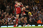 Wales wing George North collects the high ball under pressure from Charles Piutau.<br /> Dove men Series 2014<br /> Wales v New Zealand<br /> 22.11.14<br /> &copy;Steve Pope -SPORTINGWALES