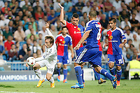 Luka Modric of Real Madrid and Samuel and Derlis Gonzalez of FC Basel 1893 during the Champions League group B soccer match between Real Madrid and FC Basel 1893 at Santiago Bernabeu Stadium in Madrid, Spain. September 16, 2014. (ALTERPHOTOS/Caro Marin) /NortePhoto.com