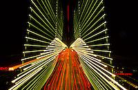 Bay Bridge lights zoomed at night in San Francisco, California, USA