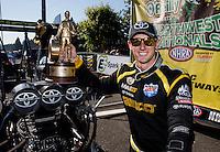 Aug. 4, 2013; Kent, WA, USA: NHRA top fuel dragster driver Morgan Lucas celebrates after winning the Northwest Nationals at Pacific Raceways. Mandatory Credit: Mark J. Rebilas-USA TODAY Sports