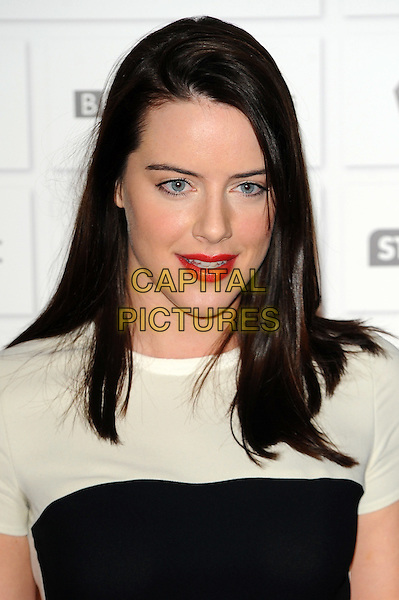 Michelle Ryan.The 14th Moet British Independent Film Awards 2011, Old Billingsgate, London, England..December 4th, 2011.headshot portrait white black red lipstick  .CAP/CJ.©Chris Joseph/Capital Pictures.