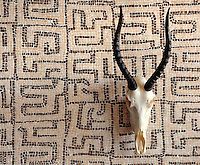 Kuba, a hand-chopped stone mosaic, is shown in tumbled Rosa Portagallo and Emperador Dark.
