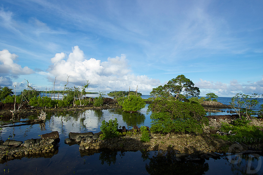 On the edge of the Ocean are the Ruins of Nan Madol the mysterious and ancient stone city at Pohnpei, also called the venice of the Pacific. A slight resemblance to Angkor Wat in style and buildings.