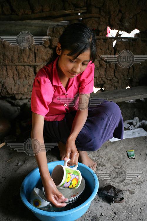 Francisca Garcia doing the washing up in the Maya Chorti (Ch'orti) indigenous community of Nueva San Isidro.
