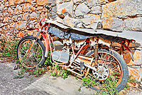 Ruined motorcycle in the medieval mastic village of Vessa on the island of Chios, Greece