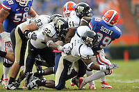21 November 2009:  FIU's linebacker Larvez Mars (3), linebacker Kenneth Dillard (41), linebacker Markieth Russell (22) and defensive end Ricky Booker (93) combine to stop Florida running back Christopher Scott (29) in the second half as the University of Florida Gators defeated the FIU Golden Panthers, 62-3, at Ben Hill Griffin Stadium in Gainesville, Florida.