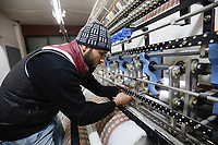 A Syrian refugee at work in a Lebanese textile factory supported by UK aid and Mercy Corps. <br /> <br /> UK aid is supporting Mercy Corps to create jobs in Lebanon, for Lebanese workers as well as Syrian refugees. The INTAJ (Improving Networks, Training and Jobs) programme is aimed at strengthening Lebanese communities by building stronger businesses and increasing employment. <br /> <br /> Picture: Russell Watkins/DFID