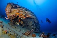 Sunken tug boat wreck with scuba divers, Bonaire, Netherlands Antilles, Caribbean, Atlantic