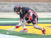 College Park, MD - April 15, 2018: Rutgers Scarlet Knights Ryan Gallagher (34) gets a ground ball during game between Rutgers and Maryland at  Capital One Field at Maryland Stadium in College Park, MD.  (Photo by Elliott Brown/Media Images International)