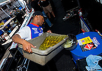 May 16, 2014; Commerce, GA, USA; NHRA top fuel dragster driver Antron Brown mixes nitro fuel in the pits during qualifying for the Southern Nationals at Atlanta Dragway. Mandatory Credit: Mark J. Rebilas-USA TODAY Sports