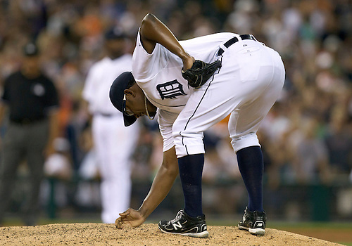 August 03, 2011:  Detroit Tigers relief pitcher Jose Valverde (#46) prepares prepares the mound prior to pitching the ninth inning during MLB game action between the Texas Rangers and the Detroit Tigers at Comerica Park in Detroit, Michigan.  The Tigers defeated the Rangers 5-4.