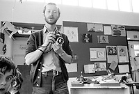 "Photographer, John Walmsley shooting the visit by American educationalist, John Holt to Julian's Primary School, Streatham, London.  1971.  John Walmsley is the author of ""Neill & Summerhill: a man and his work"" about A.S.Neill and the democratic school he founded, Summerhill, published by Penguins in 1969.  He went on to photograph education in the UK over the next 40+ years."