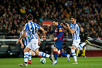 7th March 2020; Camp Nou, Barcelona, Catalonia, Spain; La Liga Football, Barcelona versus Real Sociedad; Lionel Messi of FC Barcelona breaks forward as Robin Le Normand of Sociedad comesto cover