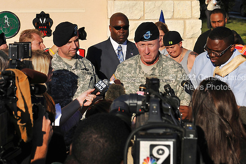 Fort Hood, TX - November 6, 2009 -- Lieutenant General Robert Cone, commanding general of III Corps and Fort Hood, Texas, gives an initial update to media members outside Fort Hood's main entrance, Friday,  November 6.  Fort Hood's commander fielded questions regarding a shooting spree that killed 13 people and wounded 30 others.  .Mandatory Credit: Michael Heckman - U.S. Army via CNP