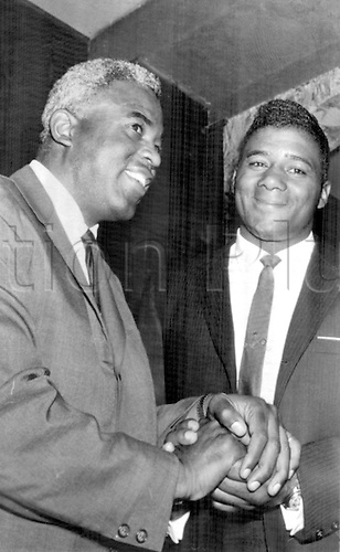 10.05.1963 New York: Ex-World heavyweight champion Floyd Patterson (right) shakes hands with Baseball star Jackie Robinson..10th May 1963