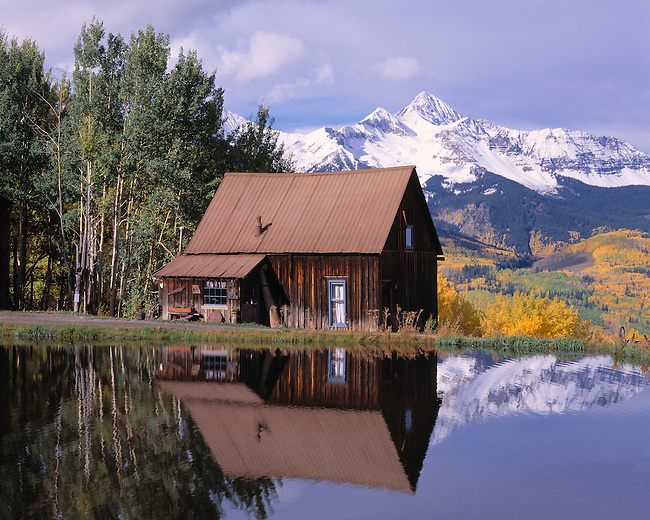 Rustic cabin near pond beneath Wilson Peak, near Telluride, CO