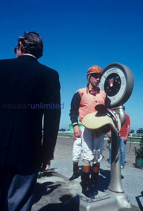 Jockey being weighed by an official before a Thoroughbred Horse race (Equus caballus), USA.