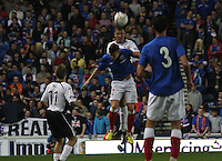 Ryan McGuffie climbs above Lewis McLeod to head in the Rangers v Queen of the South Quarter Final match in the Ramsdens Cup played at Ibrox Stadium, Glasgow on 18.9.12.