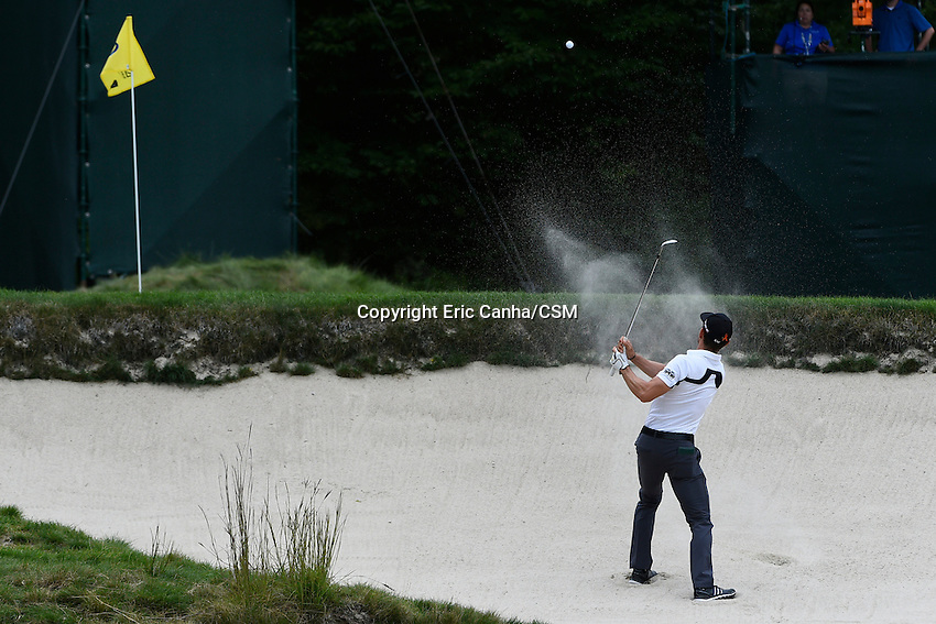 August 31, 2014 -  Norton, Mass. - Camilo Villegas works hit way out of a sand trap on the 4th hole during the third  round of the PGA FedEx Cup playoffs, Deutsche Bank Championship, held at the Tournament Players Club in Norton Massachusetts. Eric Canha/CSM