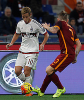 Calcio, Serie A: Roma vs Milan. Roma, stadio Olimpico, 9 gennaio 2016.<br /> AC Milan's Keisuke Honda, left, is challenged by Roma's Lucas Digne during the Italian Serie A football match between Roma and Milan at Rome's Olympic stadium, 9 January 2016.<br /> UPDATE IMAGES PRESS/Riccardo De Luca