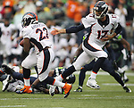 DenverBroncos quarterback Brock Osweiler (17) hands off to running back C.J. Anderson during the first quarter at CenturyLink Field on August 14, 2015 in Seattle Washington.  The Broncos beat the Seahawks 22-20.  © 2015. Jim Bryant Photo. All Rights Reserved.