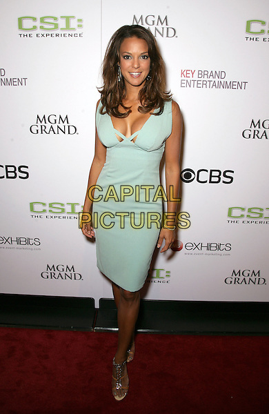 "EVA LaRUE.The Cast and crew of CSI celebrate the opening of ""CSI: The Experience"" inside the MGM Grand Resort Hotel and Casino, Las Vegas, Nevada, USA..September 12th, 2009.full length la rue blue dress pale low cut neckline cleavage.CAP/ADM/MJT.© MJT/AdMedia/Capital Pictures."