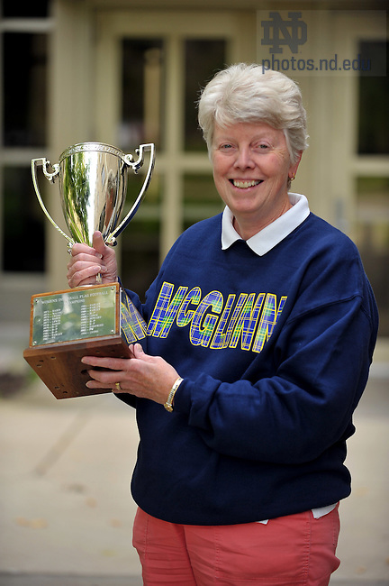 Sister Mary Lynch, rector of McGlinn Hall, poses with the Women's Interhall Football championship trophy...Photo by Matt Cashore/University of Notre Dame