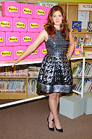 "NEW YORK - AUGUST 22: Debra Messing attends the ""Post-It Your Words Stick With Them"" PS 15 school adoption at PS 15 Roberto Clemente Elementary School on August 22, 2012 in New York City. Credit: mpi81/MediaPunch Inc. /NortePhoto.com<br />