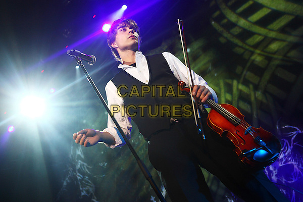 Alexander Rybak.Concert in Moscow, Russia..November 28th, 2009 .on stage in concert live gig performance performing music half length black waistcoat white shirt violin  .CAP/PER/SB.© SB/Persona/CapitalPictures