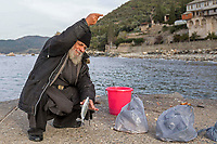 Mount Athos - The Holy Mountain.<br /> A monk fishes outside of Xenophontos monastery. <br /> <br /> Photographer: Rick Findler