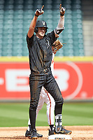 Connor Kaiser (12) of the Vanderbilt Commodores signals to his teammates after hitting a double against the Sam Houston State Bearkats in game one of the 2018 Shriners Hospitals for Children College Classic at Minute Maid Park on March 2, 2018 in Houston, Texas. The Bearkats walked-off the Commodores 7-6 in 10 innings.   (Brian Westerholt/Four Seam Images)