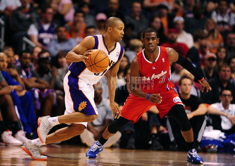 Mar. 2, 2012; Phoenix, AZ, USA; Phoenix Suns guard Sebastian Telfair (left) controls the ball under pressure from Los Angeles Clippers forward Chris Paul at the US Airways Center. The Suns defeated the Clippers 81-78. Mandatory Credit: Mark J. Rebilas-USA TODAY Sports